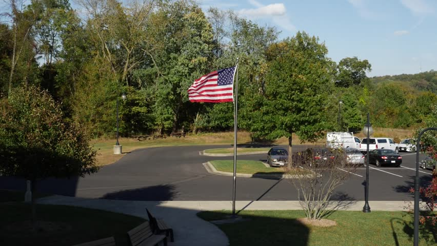 American Flag Blowing the Wind Isolated on Blue Sky with Clouds Wide #31651717