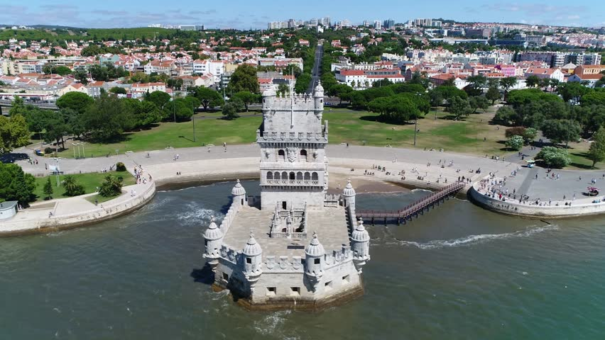 Aerial of Belem Tower Lisbon moving to right in Portuguese Torre de Belem or Tower of St. Vincent is fortified tower located in civil parish of Santa Maria de Belem in municipality of Lisbon Portugal