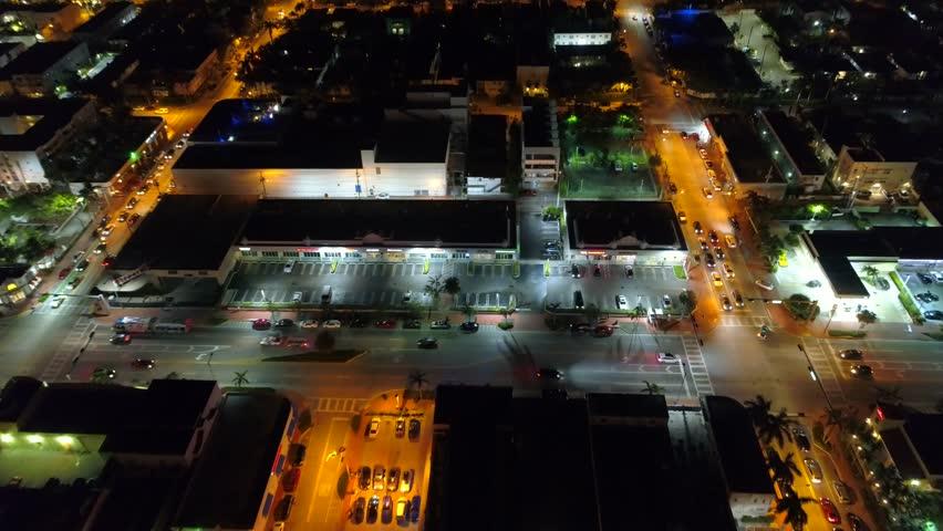 Aerial tilt down shopping plaza at night | Shutterstock HD Video #31666558
