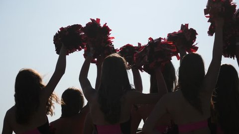 Cheerleader Young Girls Team Silhouettes Raise Hands Sway Wag Pom Poms During Performance Show