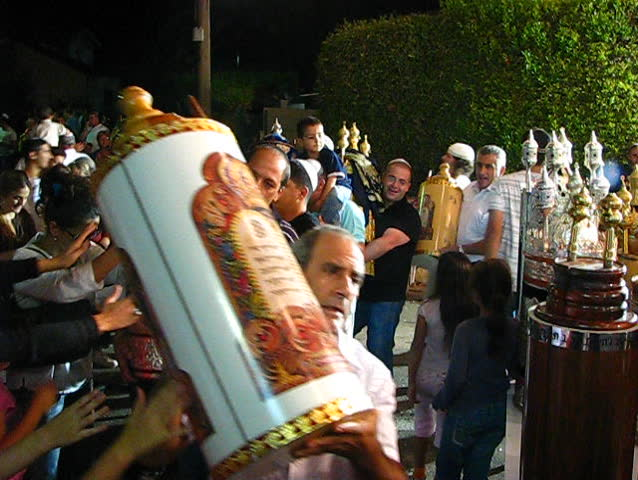 TIVON, ISRAEL – CIRCA 2008: Men dance with Bible scrolls during the ceremony of Hakafot Suchot Simchas Torah, lit. 'Rejoicing with/of the Torah' Tivon, Israel Circa 2008 #3168898