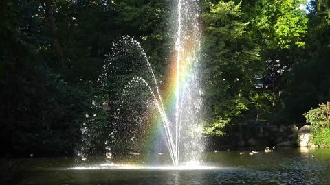 Rainbow in the fountain. The Botanical Garden is located across the street from Nantes Railway Station. FRANCE, NANTES -  September 2017.