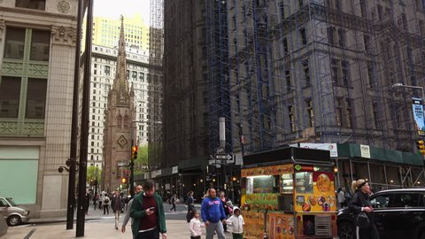 New York-circa 2017: Heavy traffic in the narrow streets of Manhattan, with stunning heights of blocks and bright advertising in the afternoon, on a sunny day, ultra hd4k, real time