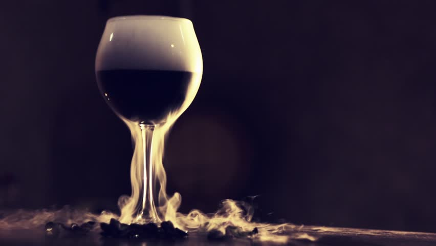 Red wine in glass with dry ice | Shutterstock HD Video #31720258