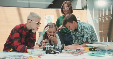 A team of children is working in the office. Discuss new toy development. Pour a machine. Feel happy. Meeting, business, businessman, busy, teamwork, write, child. Contemporary design. Modern toys