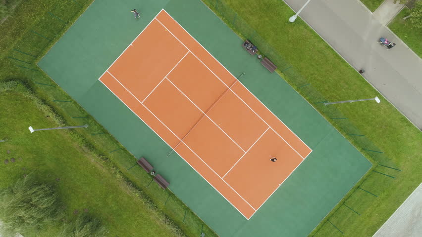 4k00 24people Are Playing Tennis On Court Aerial Vertical Top View