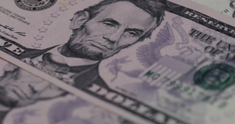 Close up heap of dollars, selective focus. Dollars, the us money background, 4K movie.   Shutterstock HD Video #31745698