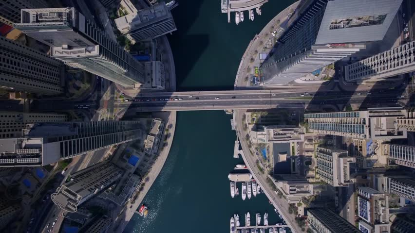 Large futuristic towers and modern skyscraper building in urban Dubai city panorama in stunning top aerial drone view | Shutterstock HD Video #31789168