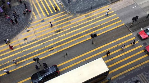 Time lapse video of the pedestrian crossing in Kong Kong. It is a top view from Chungking Mansions famous with its budget accommodation