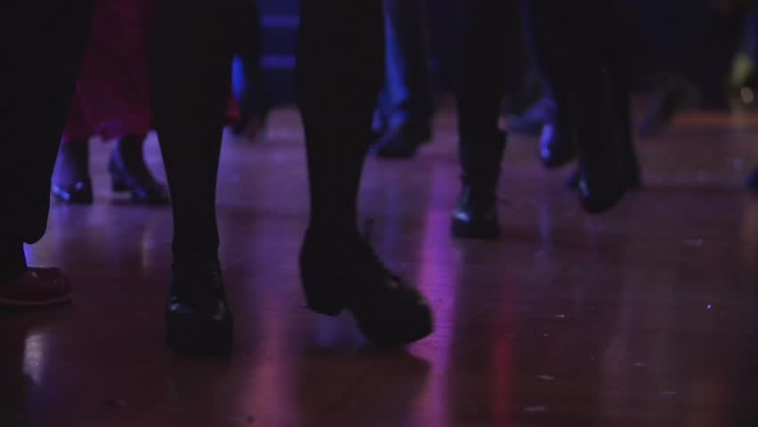 Amazing bottom shot of boots dancing a line dancing at a party. People having fun at disco club. Entertainment industry, friday night and holidays concept. #31805698