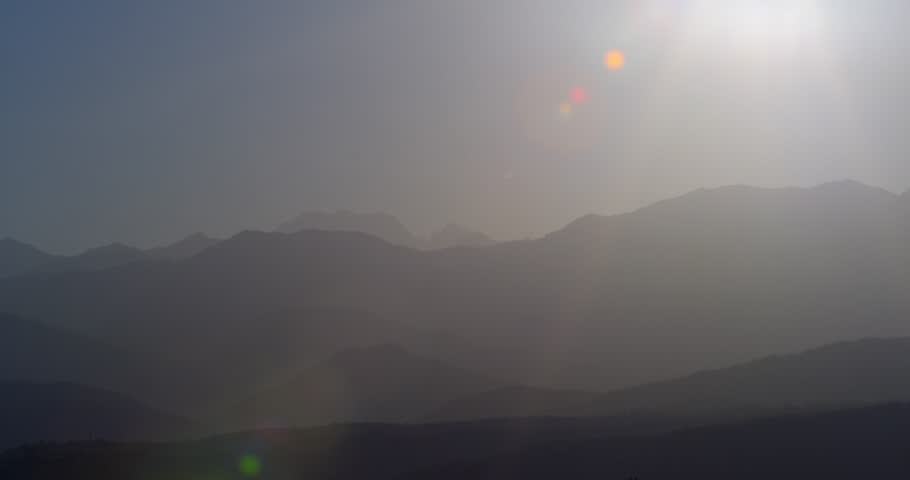 Sunrise. Mountains with clouds formation