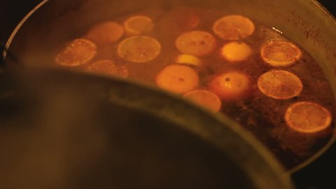 Caring cook thoroughly mixing mulled wine letting it boil before serving