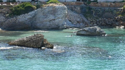 Clear blue seas with rocks in them in Cala Pi Mallorca Spain