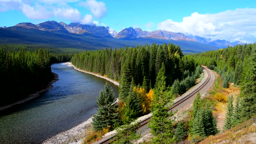 Canadian Pacific Railway freight train near Bow River at Morants Curveat in Banff National Park, Canada oldest national park and part of a UNESCO World Heritage Site.