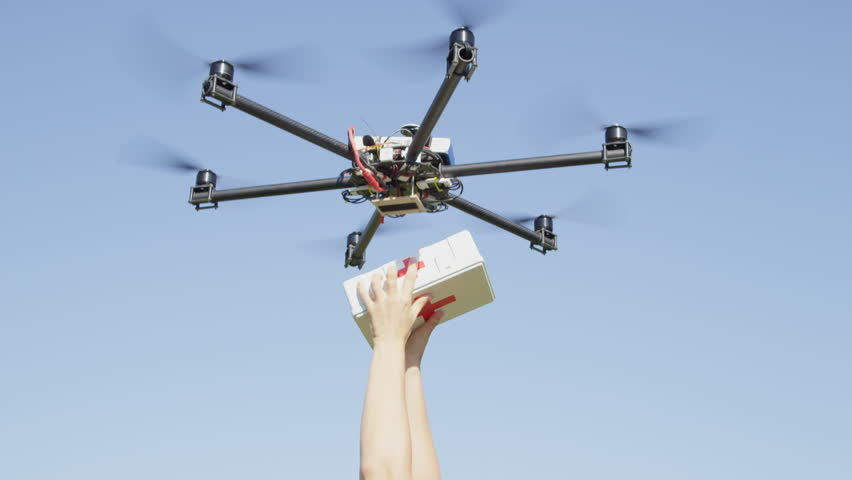 CLOSE UP: UAV aerial drone delivery. Multicopter flying with first aid medicine package. Person' arms receiving first aid SOS delivery drone from sky. Medical air shipment by first responder drone | Shutterstock HD Video #31866358