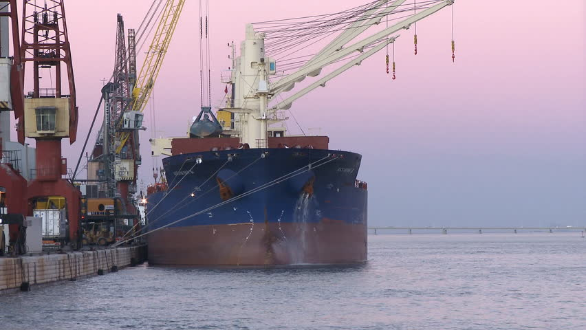 Cargo ship moving load at port Time lapse