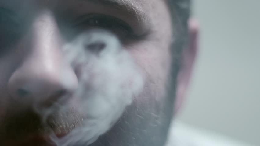 SUPER 35MM CAMERA - Bearded man smoking a cigarette