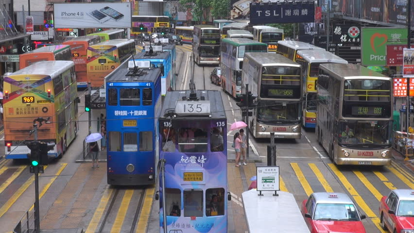 HONG KONG - CHINA, MAY 15, 2012, Heavy bus traffic in downtown city, bustling street by day