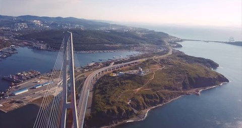 Amazing aerial view of the Russky Bridge, the world's longest cable-stayed bridge, and the Russky (Russian) Island in Peter the Great Gulf in the Sea of Japan. Sunrise. Vladivostok, Russia
