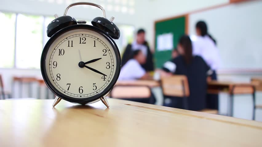 Alarm Clock Located On Wood Teacher Table In Final Exam Room Of Secondary School College University Clroom Students Asia Thailand