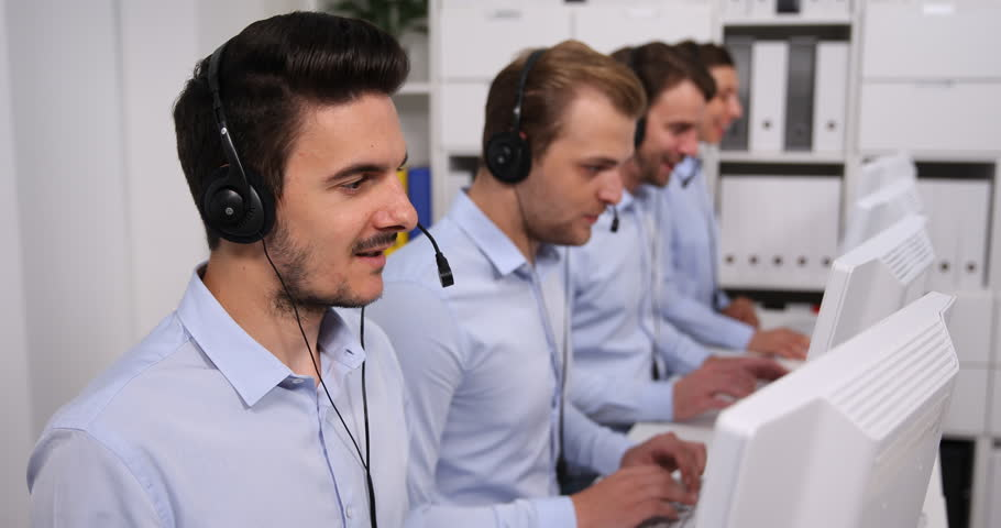 Friendly Mixed Ethnicity Telesales Team Taking Calls in Busy Call Center Office | Shutterstock HD Video #31906081