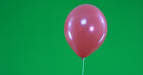 Green screen of red Balloons that rise