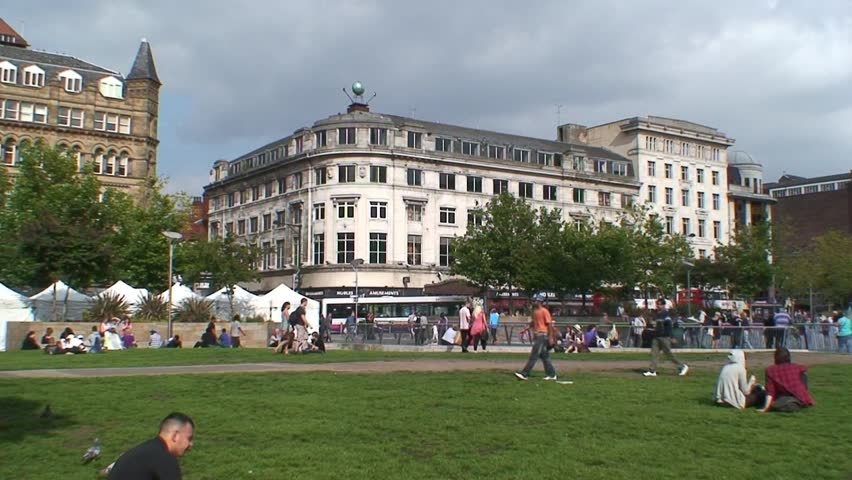 MANCHESTER, ENGLAND - CIRCA 2011: A busy Piccadilly Gardens in Manchester City Center.