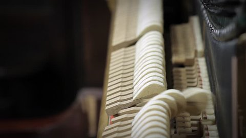Hammers Hitting Inside a Piano. Close-Up. Close-Up.