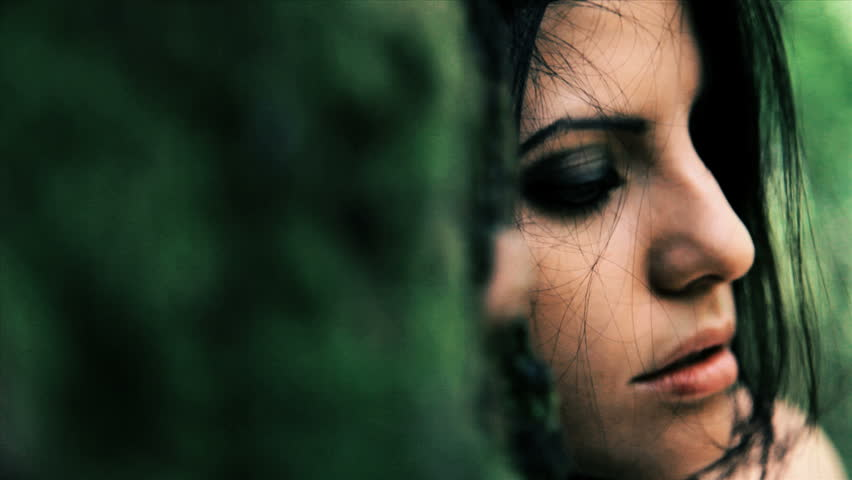Beautiful woman feeling lonely and desperate sitting in forest closeup | Shutterstock HD Video #3193606