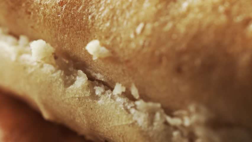 Bagel bun extreme close up stock footage. Bagel bun in macro close up with a sliding camera move.