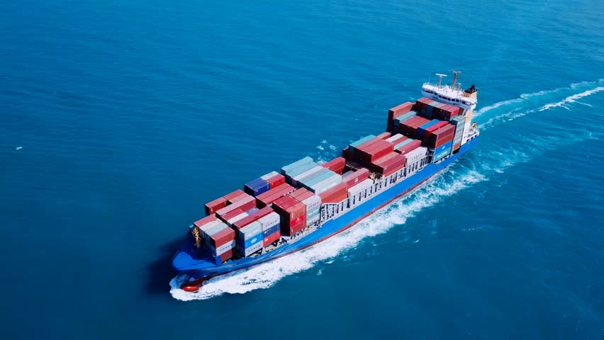 Mediterranean sea - October 20, 2017: Aerial footage of a Blue container ship loaded with various container brands, at sea.