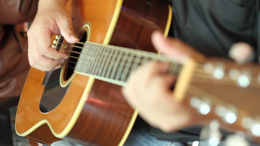 hd video of guitarist playing acoustic guitar