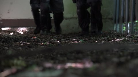 Close up of the shoes of a walking Special Force Team.