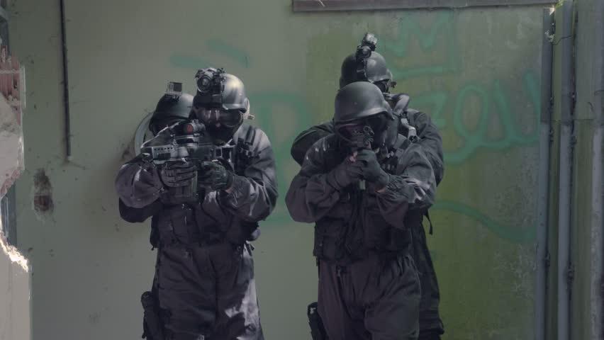 A Special Force Team walk through a open corridor. | Shutterstock HD Video #32000698