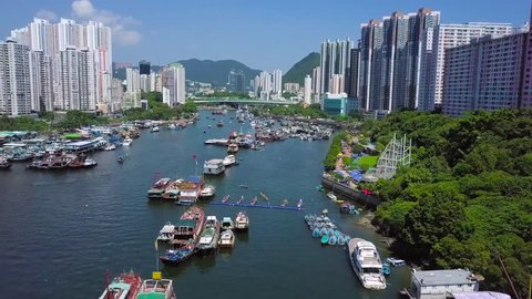 forward shot of the Aberdeen typhoon shelter and buildings in Aberdeen and Apleichau in Hong Kong