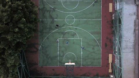 overhead circling shot of an outdoor basketball field in Hong Kong (4K)