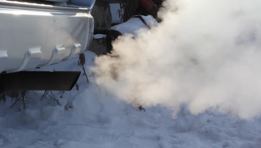 Exhaust gases from the muffler running car.