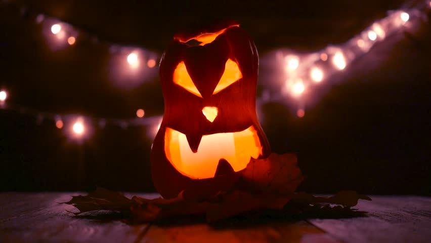 Carved Halloween pumpkin with lights on background. Dark key footage in UltraHd resolution. | Shutterstock HD Video #32098468