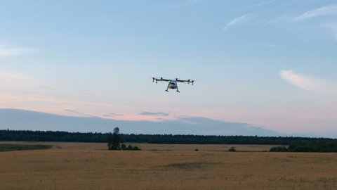 Modern agriculture drone flying over field. Shot in Red Epic Dragon