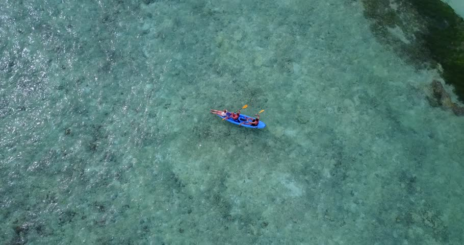V09374 People enjoying boats and watersports with view from aerial flying drone in clear aqua blue sea water and blue sky | Shutterstock HD Video #32118418
