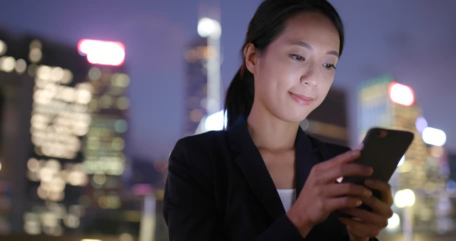 Business woman use of cellphone at nigh  | Shutterstock HD Video #32126653
