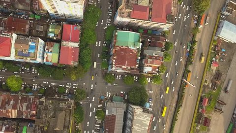 4K Aerial, drone flight over road junction,streets at China Town and city of Yangon,Myanmar
