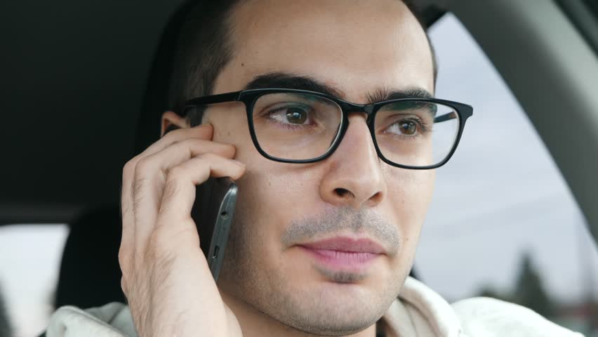 Closeup of man talking to his smartphone inside a car. | Shutterstock HD Video #32144578