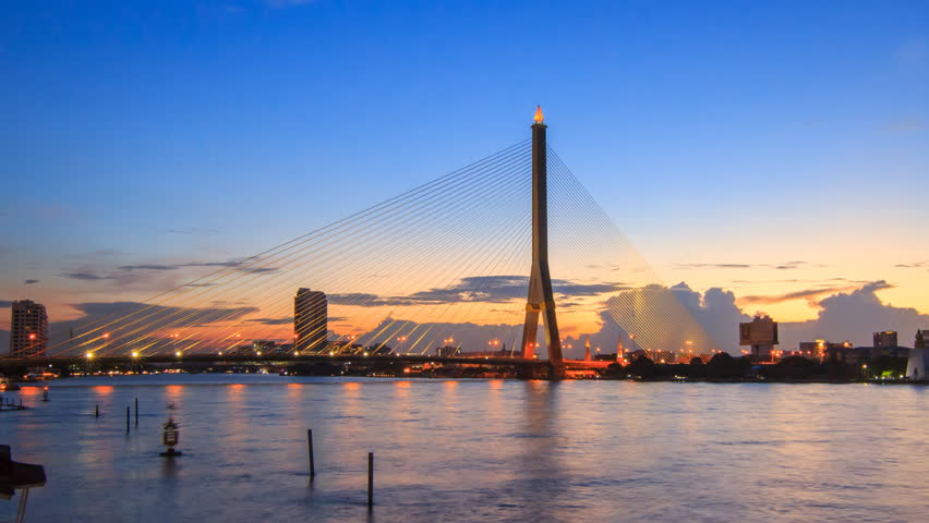 Day to night time lapse of Big Suspension bridge in Sunset time / Rama 8 bridge in sunset time