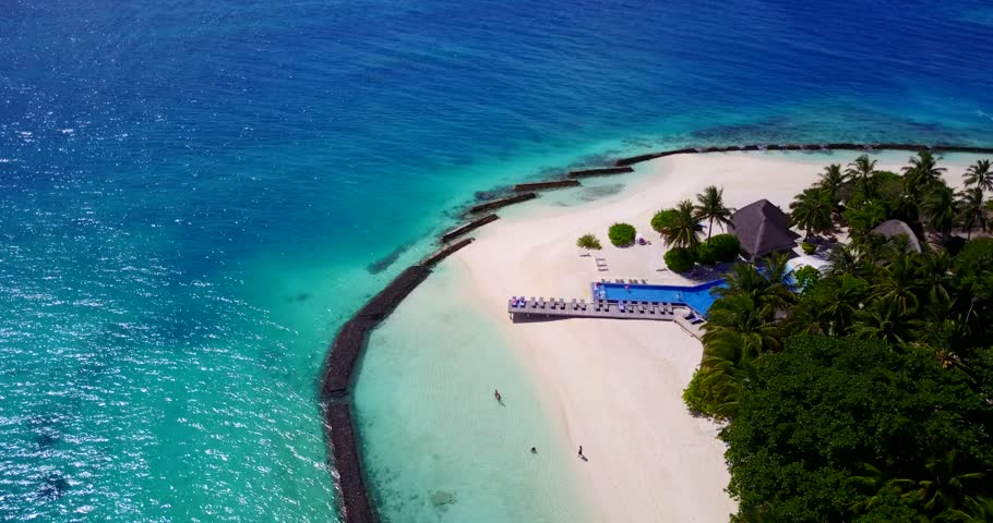 v09440 five 5 star resort water bungalows in Maldives with drone aerial flying view on white sand beach on tropical island