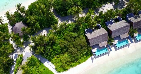 v09546 five 5 star resort water bungalows in Maldives with drone aerial flying view on white sand beach on tropical island