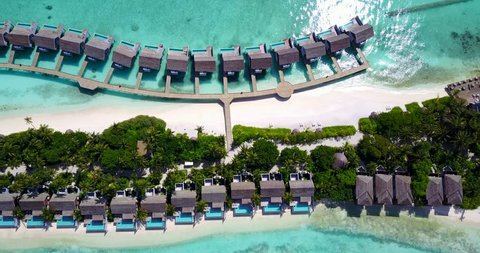 v09562 five 5 star resort water bungalows in Maldives with drone aerial flying view on white sand beach on tropical island