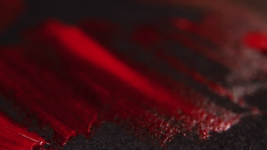 Painting Red on Black Close Up 2