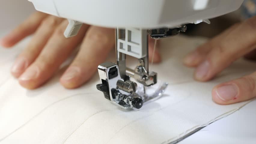 Sewing machine in work close up. | Shutterstock HD Video #32238988