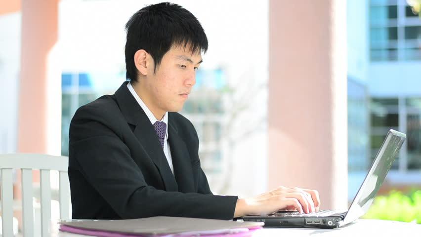 businessman looking at computer screen and has good news